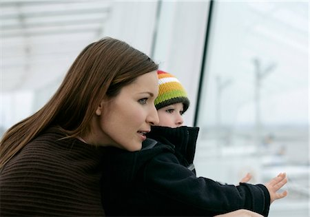 Mother and son looking out, Munich airport, Bavaria, Germany Stock Photo - Premium Royalty-Free, Code: 628-05817422