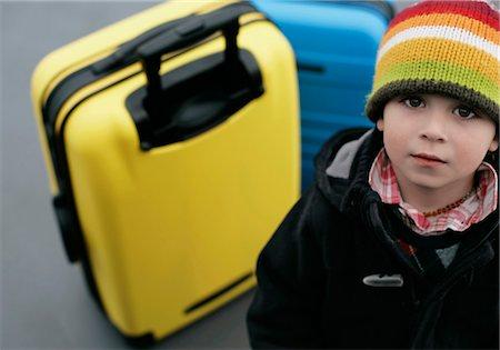 Boy looking at camera, Munich airport, Bavaria, Germany Stock Photo - Premium Royalty-Free, Code: 628-05817423