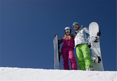 sports and snowboarding - Young couple with snowboards Stock Photo - Premium Royalty-Free, Code: 628-05817551