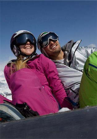 sports and snowboarding - Young couple with snowboard sitting in snow Stock Photo - Premium Royalty-Free, Code: 628-05817552