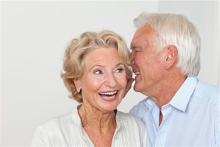 Senior couple whispering Stock Photo - Premium Royalty-Free, Code: 628-05817564