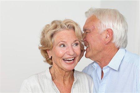 Senior couple whispering Stock Photo - Premium Royalty-Free, Code: 628-05817564