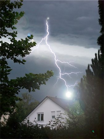 Lightning strikes into house Stock Photo - Premium Royalty-Free, Code: 628-05817574