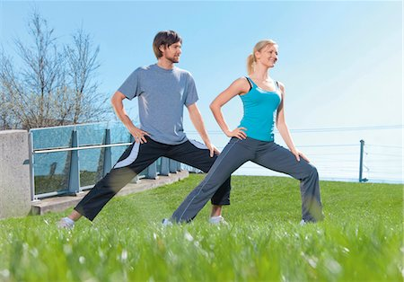 Man and woman doing gymnastics in meadow Stock Photo - Premium Royalty-Free, Code: 628-05817585