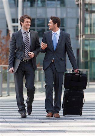 Two smiling businessmen using crosswalk Stock Photo - Premium Royalty-Free, Code: 628-05817588