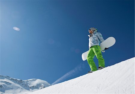 sports and snowboarding - Man standing with snowboard at halfpipe Stock Photo - Premium Royalty-Free, Code: 628-05817608