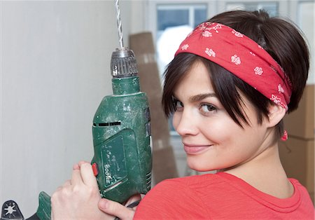 Young woman holding electric drill Stock Photo - Premium Royalty-Free, Code: 628-05817627