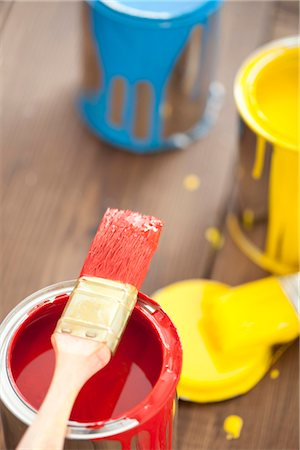 spot paint - Paint can with paintbrush on wooden floor Stock Photo - Premium Royalty-Free, Code: 628-05817697