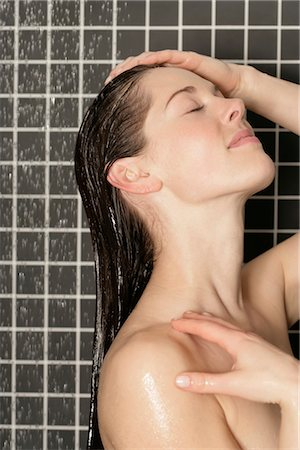 Woman taking a shower Stock Photo - Premium Royalty-Free, Code: 628-05817729