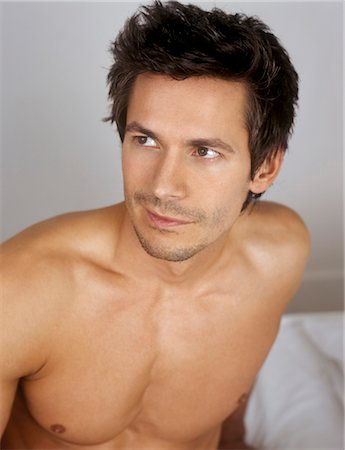 Barechested man looking up Stock Photo - Premium Royalty-Free, Code: 628-05817735