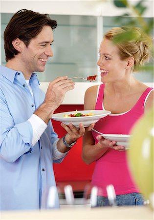 Man feeding a woman Stock Photo - Premium Royalty-Free, Code: 628-05817757
