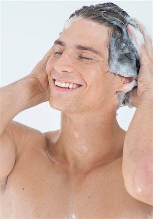 Young man washing hair Stock Photo - Premium Royalty-Free, Code: 628-05817752