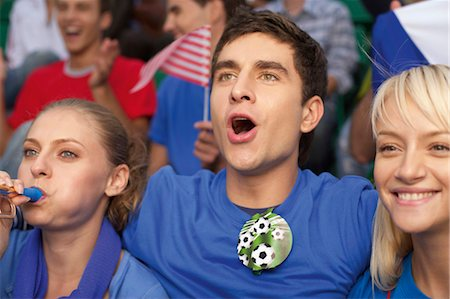 soccer fan - Fans in a soccer stadium Stock Photo - Premium Royalty-Free, Code: 628-05817771