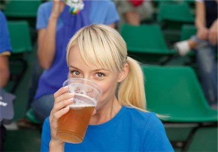 soccer fan - Female fan drinking beer in a stadium Stock Photo - Premium Royalty-Free, Code: 628-05817773