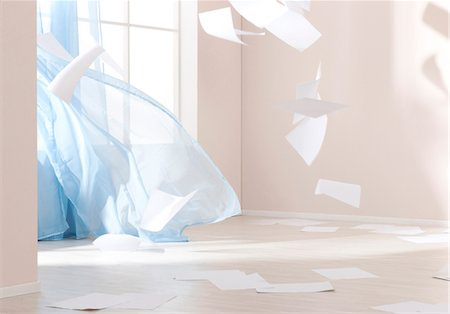 Papers are blown through room Stock Photo - Premium Royalty-Free, Code: 628-05817821