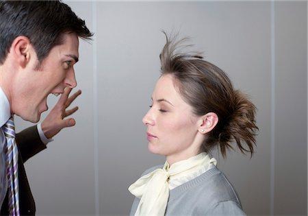 Businessman screaming at woman Stock Photo - Premium Royalty-Free, Code: 628-05817956