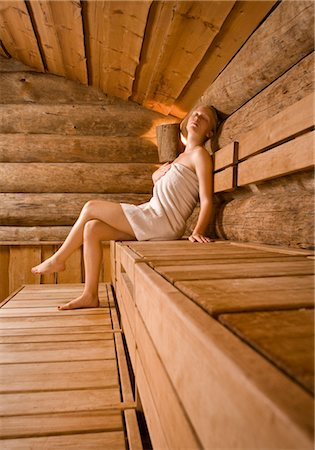 Woman sitting in sauna Stock Photo - Premium Royalty-Free, Code: 628-05817970