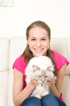 preteen girl pussy - Happy teenage girl with cat, Munich, Bavaria, Germany Stock Photo - Premium Royalty-Free, Code: 628-05818116