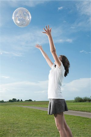 Girl playing with transparent globe outdoors Stock Photo - Premium Royalty-Free, Code: 628-07072088