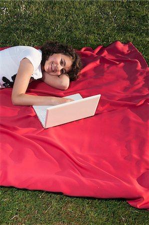 Girl using laptop on blanket Stock Photo - Premium Royalty-Free, Code: 628-07072115