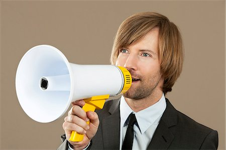 Businessman holding megaphone Stock Photo - Premium Royalty-Free, Code: 628-07072196