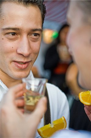 Couple drinking Tequila on the Oktoberfest in Munich, Bavaria, Germany Stock Photo - Premium Royalty-Free, Code: 628-07072372