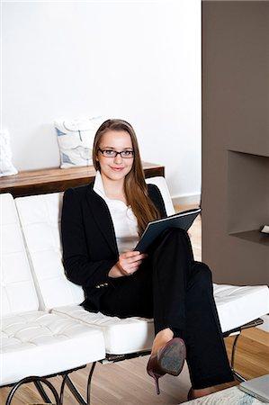 Smiling teenage girl holding folder Stock Photo - Premium Royalty-Free, Code: 628-07072451
