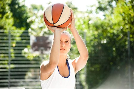 Teenage girl throwing basketball Stock Photo - Premium Royalty-Free, Code: 628-07072461