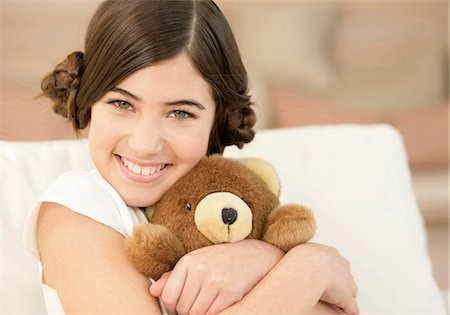 Girl hugging teddy bear Stock Photo - Premium Royalty-Free, Code: 628-07072525