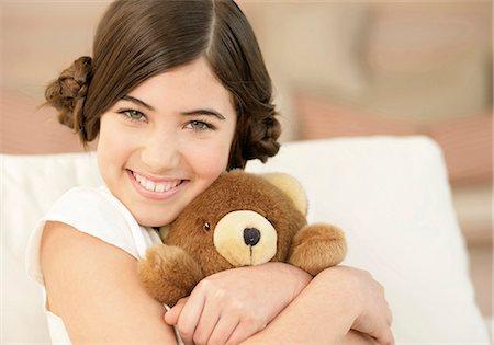 Girl hugging teddy bear Stock Photo - Premium Royalty-Free, Code: 628-07072525