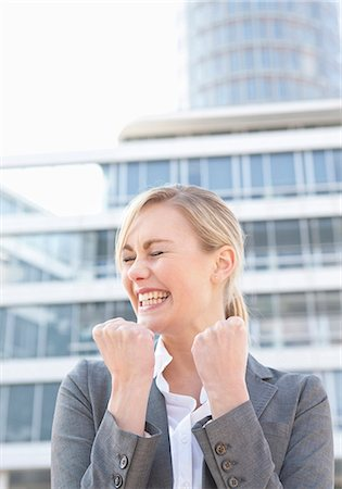 Happy businesswoman clenching fists Stock Photo - Premium Royalty-Free, Code: 628-07072530