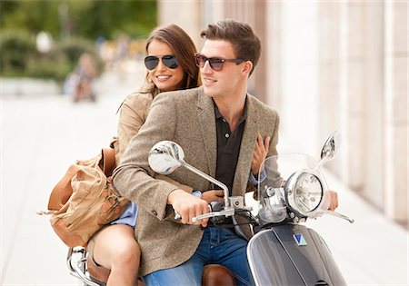 Young couple on motor scooter Stock Photo - Premium Royalty-Free, Code: 628-07072549