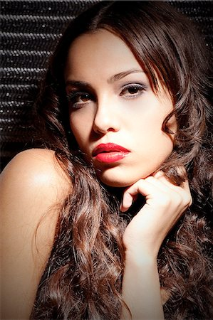 Brunette young woman with lipstick Stock Photo - Premium Royalty-Free, Code: 628-07072590