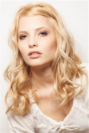 Blond woman wearing white top Stock Photo - Premium Royalty-Free, Code: 628-07072610