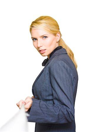 Blond businesswoman pulling rope Stock Photo - Premium Royalty-Free, Code: 628-07072648