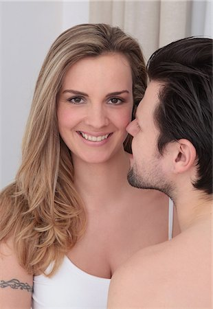 Barechested man looking at smiling woman Stock Photo - Premium Royalty-Free, Code: 628-07072768
