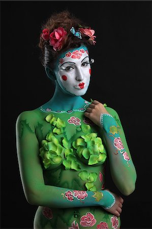 Young woman with traditional Asian body painting Stock Photo - Premium Royalty-Free, Code: 628-07072946