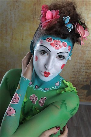 Young woman with traditional Asian body painting, portrait Stock Photo - Premium Royalty-Free, Code: 628-07072947