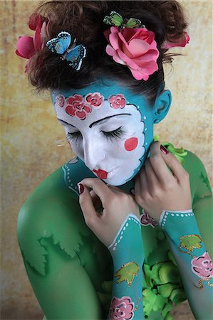 Young woman with traditional Asian body painting Stock Photo - Premium Royalty-Free, Code: 628-07072949