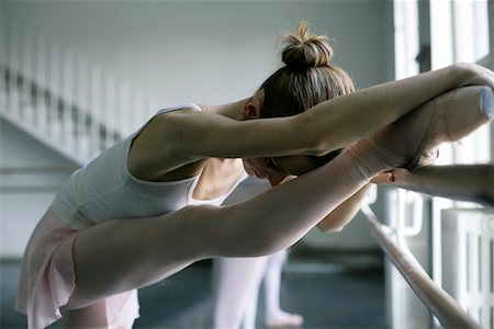 Female ballet dancer doing stretching exercising at a ballet bare Stock Photo - Premium Royalty-Free, Code: 628-00919287