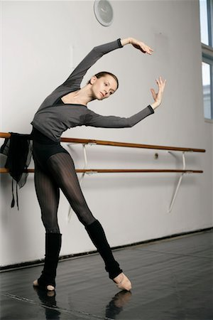 A female ballet dancer doing exercises Stock Photo - Premium Royalty-Free, Code: 628-00919384