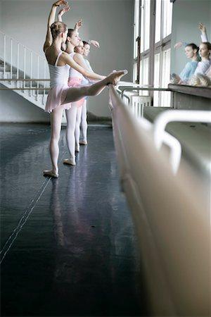 Female ballet dancers doing exercising at the ballet bare Stock Photo - Premium Royalty-Free, Code: 628-00919390
