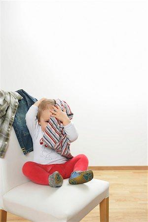 shy baby - Baby boy hiding under a shirt Stock Photo - Premium Royalty-Free, Code: 628-00920314