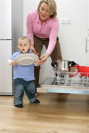 Son and mother emptying a dishwasher Stock Photo - Premium Royalty-Free, Code: 628-00920355