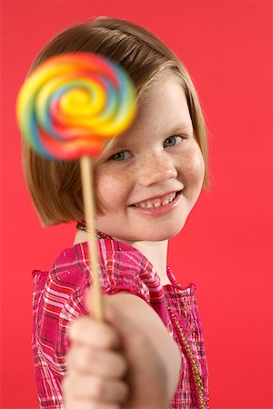 red lollipop - Girl holding a lolly Stock Photo - Premium Royalty-Free, Code: 628-01711938