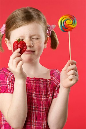 red lollipop - Girl with lolly and strawberry Stock Photo - Premium Royalty-Free, Code: 628-01711963