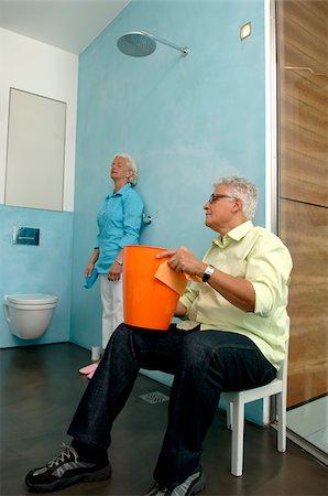 Senior couple cleaning bathroom Stock Photo - Premium Royalty-Free, Code: 628-02615240