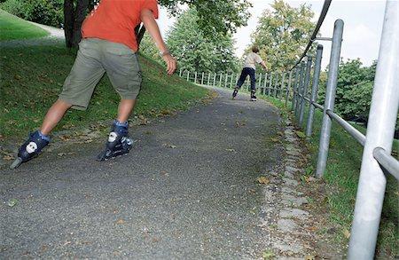 Blonde Boy rollerblading - Leisure Time - Parkway Stock Photo - Premium Royalty-Free, Code: 628-02615710