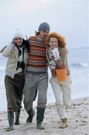 Two young Women with a Man between them strolling along the Beach - Friendship - Trip - Season Stock Photo - Premium Royalty-Free, Code: 628-02954641