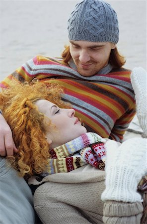 Young Woman with red Curls lying in the Lap of her Boyfriend - Relationship - Togetherness - Season Stock Photo - Premium Royalty-Free, Code: 628-02954656